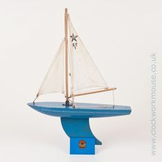 A lovely little vintage Star Yacht SY/1 toy sailing boat in 'Sea Blue' and complete with one of our popular reproduction Star Yacht display stands.