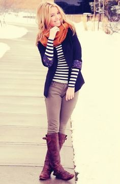 striped shirt, blazer with floral cuff detail, khaki skinny pants, brown boots and an orange scarf.