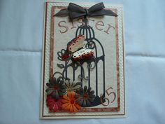 Layered card with birdcage die and layered butterfly die in different colours. Lettering and numbers Cuttlebug die cuts.