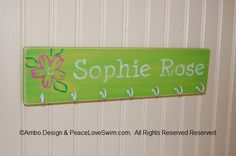Girl's Custom Personalized Swimming Ribbon and Medal Display Hanger.  Also great for hanging necklaces & bracelets!  Only available at www.PeaceLoveSwim.com