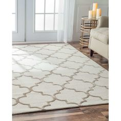 This Trellis Handmade Wool Area Rug Uses Subtle And Modern Colors With Highlights Of Faux Silk To Match Todays Interiors The Plush Pile Offers Great