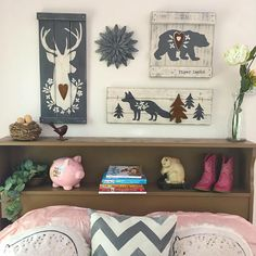 This set of 4 rustic woodland gallery wall art will set the theme in any girls woodland- inspired room, from nursery to tween! The 4 piece set includes: - a DEER HEAD painting (24 x 10.5) - a BEAR painting (14 x 14) - a FOX and tree painting (24 x 8.5) - a galvanized tin flower (10) Each wood piece includes a three dimensional rusty tin accent. The paintings are then distressed using our unique technique to reveal wood grains and create a vintage old, weathered effect. OPTIONAL NAME: add a…