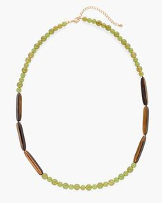 Lustrous green beads harmonize with faux tiger's-eye pieces in this brilliantly balanced single-strand necklace.  Plastic, metal.  Imported.