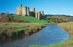 Kidwelly Castle (Castell Cydweli) is a Norman Castle overlooking the River Gwendraeth and the town of Kidwelly. The present remains of the castle include work from about 1200 to about 1476.