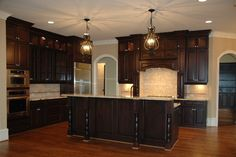 staining kitchen cabinets ideas   kitchen: dark stained cabintets and hutch with stainless appliances
