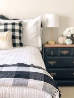 Adding Buffalo Check to my Guest Room – One Home to Another A modern farmhouse styled guest room with accents of buffalo check, white bedding and vintage pieces of furniture re-done. Home Decor Bedroom, Modern Bedroom, Bedroom Furniture, Home Furniture, Bedroom Ideas, Bedroom Designs, Guest Room Bedding Ideas, Bedding Sets, Black Furniture