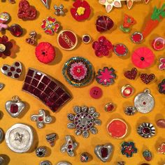 """Some buttons and barrettes on display at the Todd Oldham """"All of Everything"""" retrospective at @risdmuseum If you have a chance to get there, this fantastic exhibit is there until 9/11/16. Todd is a genius!  #tbt  #risd #toddoldham #style #90sfashion #fashion #bbloggers #bblogger #bostonblogger #allofeverything"""