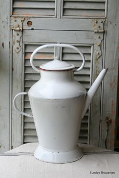 Antique French Enamel Watering Can. I have one of these in a nice duck egg blue.