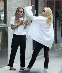 Mary-Kate and Ashley outside their office in NYC on August 25, 2016 (via…