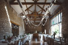 Wedding flags decor in a rustic wedding at Folly Farm - a beautiful countryside reserve close to Bath & Bristol, UK | Photo by Liron Erel Echoes & Wild Hearts