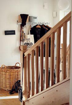 metal rack and wooden hangers