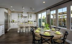 The dining area and kitchen connect seamlessly to create the hub of the home. - The Rosewood - Cottage Eight at Camden Place in Hayward, CA
