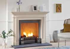 The Burlington fireplace is a timeless design carved from limestone.