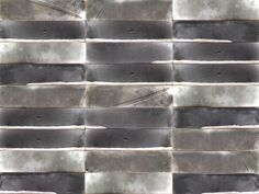 Handmade industrial style rectangular tile, fired in a raku kiln.
