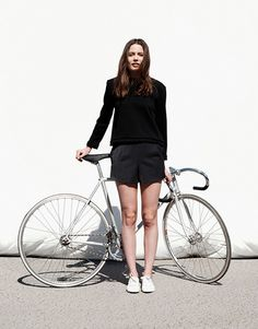 Silver bike style with black saddle and handlebars. See more stylish women on bikes at melisinestudio.com and @melisinestudio on instagram.