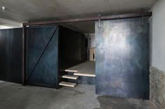 Full Height Steel Sliding Barn Door from Cinema Sil Plaz in Switzerland, Remodelista