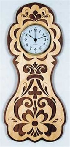 Woodworking For Kids Rosemaling Wall Clock Plan - Cherry Tree Toys can provide you with all the woodworking supplies to complete project from woodworking plans, wood parts, lumber, clock parts and scroll saw plans.