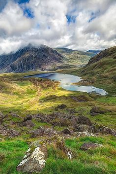 A craggy landscape gives way to a beautiful lake in North Wales.