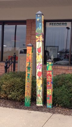 Painted poles for the garden