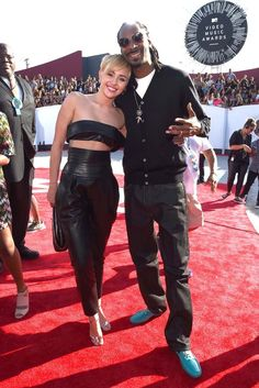 Miley Cyrus and rapper Snoop Dogg [Photo by Larry Busacca/Getty Images for MTV]