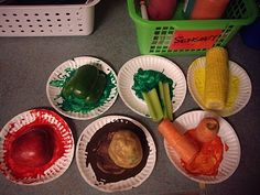 Toddler art: painting with stuff grown on the farm. Broccoli, Corn, Apple, Potato, Carrot