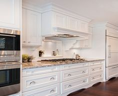 """Benjamin Moore Color...""""oxford white."""" A classic white that is strong and clean, taking a fresh turn on the modern side. I love this kitchen. WoW."""