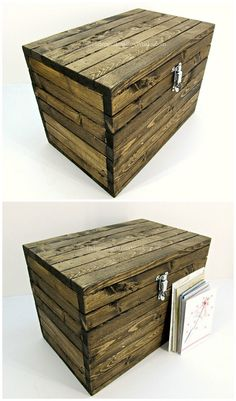 This handmade medium wooden storage box has been sanded and stained with a dark walnut wood stain. The hardware consists of 2 round silver