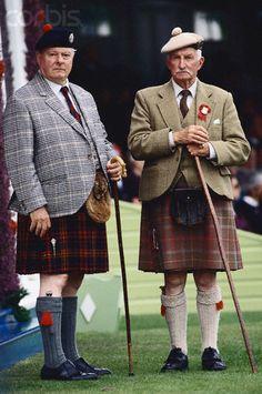 Two Salt-of-the-earth Scotsmen in traditional tartan kilts and tam o'shanter hats at Braemar Games Aberdeenshire, Scotland.  September 1994
