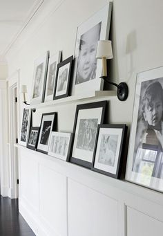CONTEMPORARY - Extra wide trim topping the wainscoting creates space to display a gallery of images