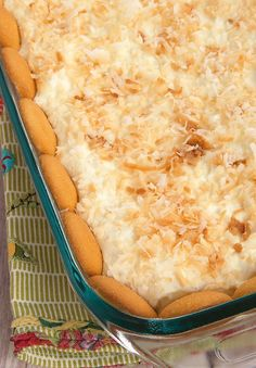 Delicious layers of cream cheese, pudding, Nilla Wafers, and toasted coconut make these Coconut Cream Pie Bars irresistible! Bring this dish to your next family get together!