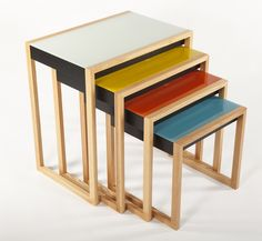 Bauhaus Nesting Tables - Designer Josef Albers dabbled in furniture design during his time at the Bauhaus, where he served as artistic director of the workshop. While at Bauhaus, he came up with this bold and colorful design for a set of nesting tables. This stunning set of nesting side and end tables are constructed with a solid oak wood frame, and topped with 4mm painted glass. The glass tops are lacquered in a retro pallet of: pale green, yellow, orange and blue.