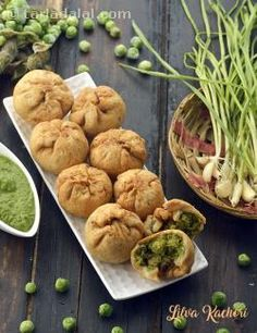 """Lilva Kachori is a traditional kachori made with a stuffing of fresh toovar and green peas perked up with ginger and green chillies.   A dash of lemon adds to the chatpata taste of the stuffing, making this a really exciting snack to bite into on a cold winter's day.   The flaky and crisp kachori with an excitingly spicy stuffing, is a must-try recipe in the winter months, when fresh toovar is available in the markets.   You can also try other kachori recipes like <a href=""""Khasta-Kacho..."""