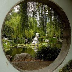 I want a round window in my garden.it reminds me of Asian Garden, Chinese Garden, Hippie House, Moon Gate, Gardens Of The World, Garden Windows, Garden Fountains, Garden Features, Window Design