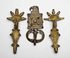 6thC Ostrogothic pair of radiate-headed bow-brooches and buckle and plate of the 'eagle' type. Crimea.