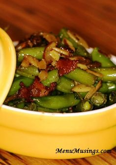 "Southern Maple Bacon Green Beans with Slivered Almonds - yes, there have been ""green bean converts"" thanks to these. With the smoky sweet flavor of the maple bacon and the crunch of the toasted almonds, they are hard NOT to like!  My daughter's absolute favorite!"