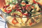 Spicy Italian sausages are the hidden delight in this traditional Mediterranean salad.