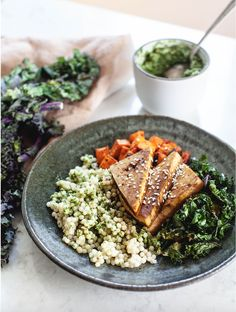 """This tofu sweet potato bowl may seem complicated, but we promise it's not! This delicious dish is the perfect lunch. Recipe featured in our """"What I Eat in a Day"""" Series. Cilantro Pesto, Tasty Dishes, Vegan Vegetarian, A Food, Food Processor Recipes, Main Dishes, Vegan Recipes, Vegane Rezepte"""