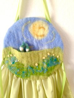 """Spring Story Apron made by Suzanne Down. Pinned with her permission from Waldorf Story and Puppetry Shop. Wet felted top with pocket for puppet magic, 45"""" silk skirt which becomes your stage when sitting for your lap story. $95 plus post (light) and comes with a spring story to get you started!"""