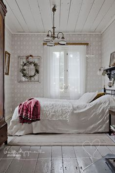 A very beautiful vintage bedroom with 1930s style light fixtures and painted hardwood floor