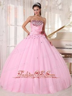 Luxurious Pink Quinceanera Dress Strapless Tulle Beading and Ruch Ball Gown    This pretty quinceanera gown features a unique intensively beaded bust with a strapless neckline on the ruched bodice.the floral design on the left accents your waist. Colorful beading scattered around the hips creates a favorable look, The skirt falls naturally to complete the look. So sweet!So sassy!