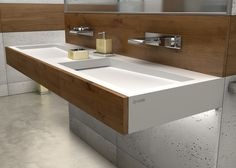 High-quality architectural concrete panels and double sinks were provided by LUXUM.