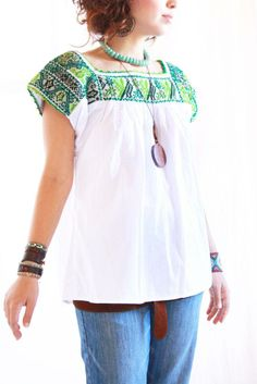 Teal Mexican blouse.