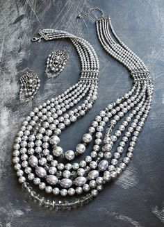 The Premiere Collection – Channel the elegance of vintage Hollywood with luxe gray faux pearls and swinging chandeliers.