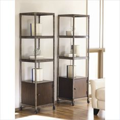Hammary Structure Etagere/Audio Pier in Distressed Brown Features:  Etagere / Audio Pier Crafted of Rubber wood Solids and Veneers with Metal Accents  Heavily Distressed Brown finish  Three fixed shelves  One door  Includes casters