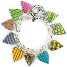 Shrinky Dink Heart Charm Bracelet - I like this idea. I think I have some shrinky dink around here somewhere. Shrinky Dinks, Beaded Jewelry, Handmade Jewelry, Jewellery, Shrink Plastic Jewelry, Shrink Art, Bijoux Diy, Heart Charm, Jewelry Crafts