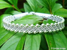 RIMFAXE Silver Sami Bracelet - Swedish Lapland Reindeer Leather Bracelet with Braided Pewter Wire and Sterling Silver Beads Custom Handmade from Tjekijas Design.