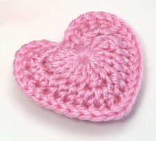 Crochet hearts...pattern given Would be cute on hats for baby...perhaps in clusters of different colors.