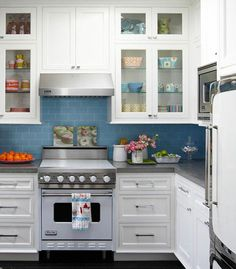 Kitchen...festive dishes and a bright backsplash add a dash of playfulness to this sophisticated kitchen.