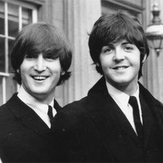 John Lennon and Paul McCartney during a ceremony at Buckingham Palace in 1965.