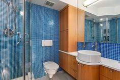 Blue Bathroom Design Ideas, Pictures, Remodel & Decor with Blue Tile, Multi-Colored Tile and Blue Walls